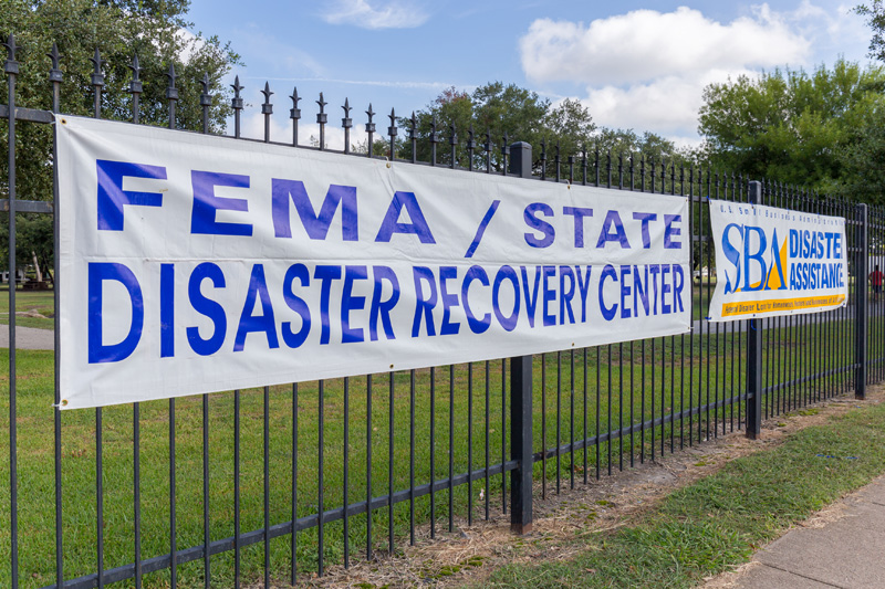 FEMA and SBA Disaster Recovery Banners on a fence