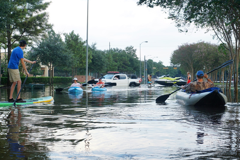 Residents use kayaks in Houston's flooded streets after Hurricane Harvey